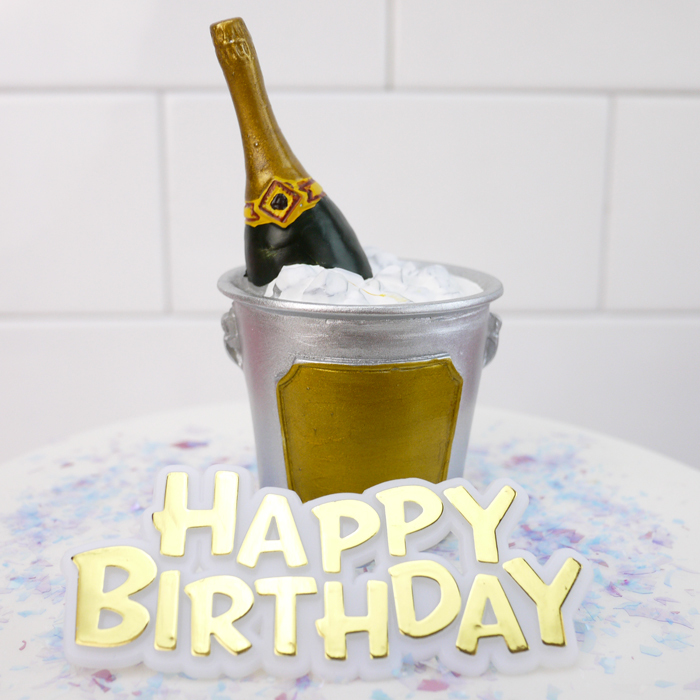 Champagne bottle on ice cake topper and happy birthday mo...